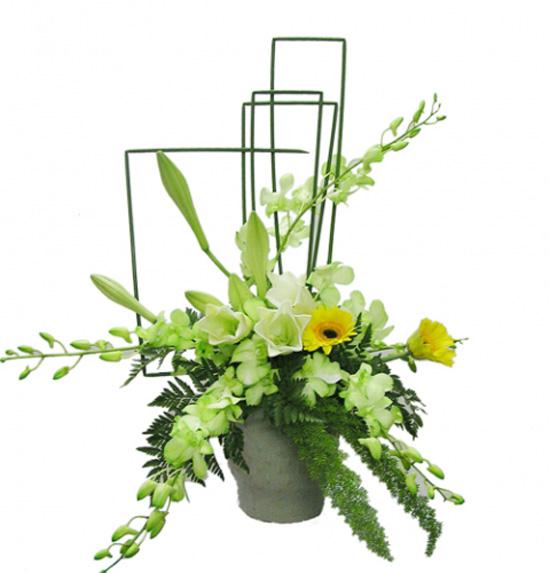 Kết quả hình ảnh cho cách cắm hoa lan tết